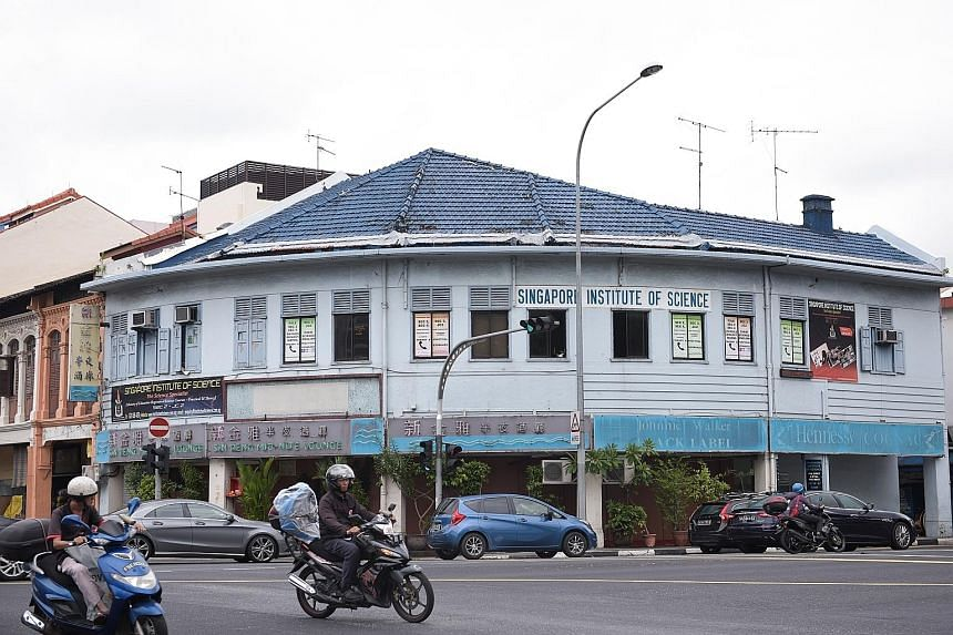 Mr Teng Tieu Guan with the Sin Peng signboard on the ground floor of his shophouse. It was the name of a coffee shop that operated there in the 1950s. Singapore Institute of Science's chief executive Thomas Jacob was once a student of the school on t