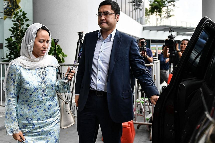 Datin Seri Rosmah Mansor leaving the Malaysian Anti-Corruption Commission (MACC) headquarters in Putrajaya yesterday afternoon after giving a statement. She had arrived at the agency at 10.45am, accompanied by her lawyers K. Kumaraendran and Geethan