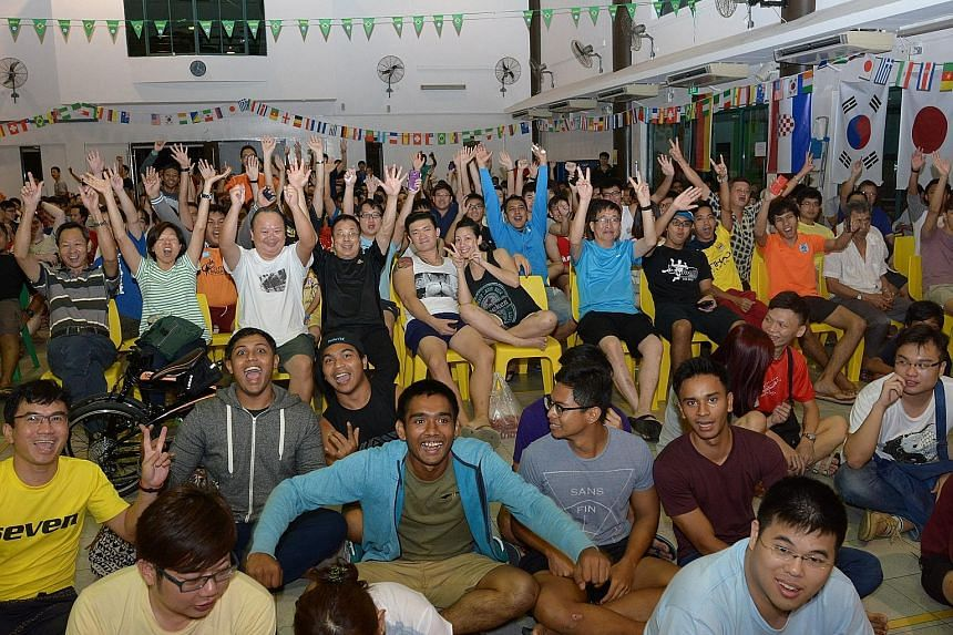About 600 football fans were at Tampines West CC to catch the World Cup 2014 game between defending champions Spain and the Netherlands.