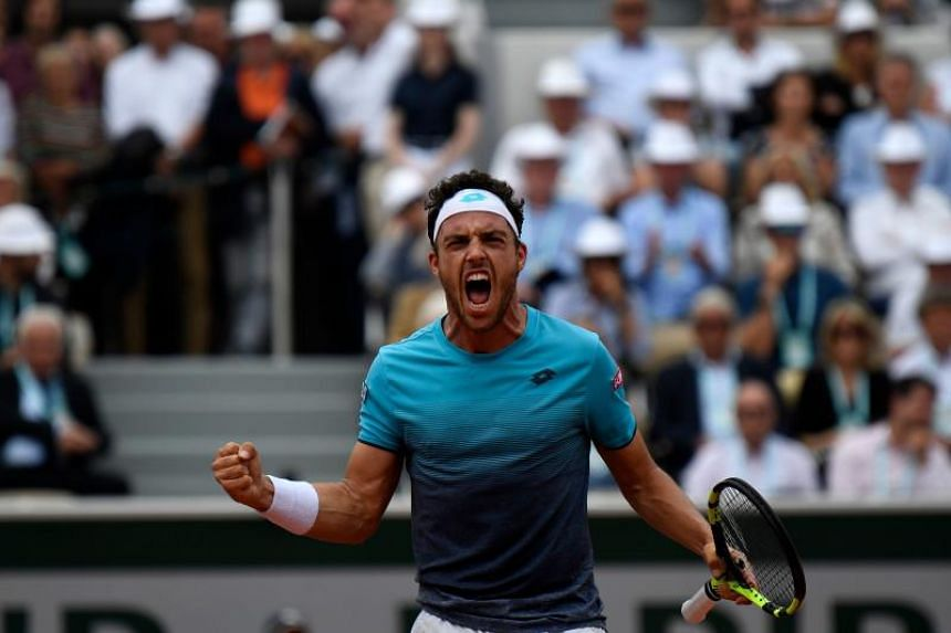 Italy's Marco Cecchinato celebrates after a point against Serbia's Novak Djokovic during their men's singles quarter-final match on day ten of The Roland Garros 2018 French Open tennis tournament in Paris on June 5, 2018.