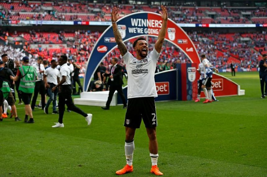 Fulham's English defender Ryan Fredericks celebrates on the pitch after the English Championship play-off final football match between Aston Villa and Fulham at Wembley Stadium in London on May 26, 2018.