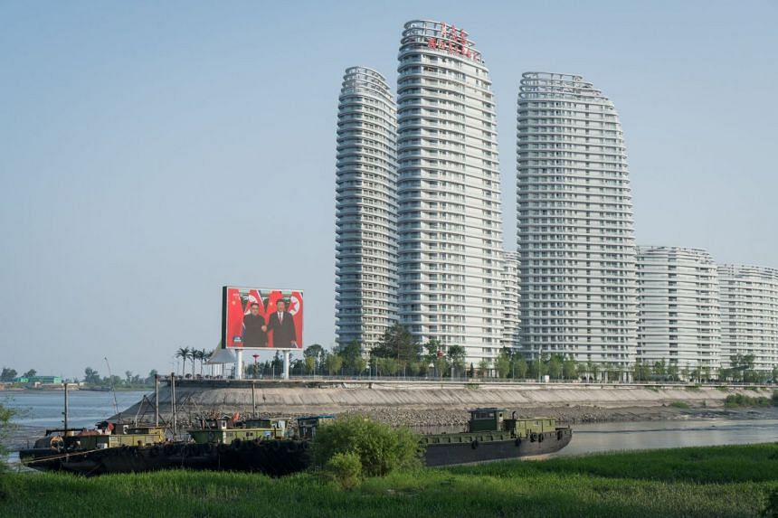 A luxury apartment complex in Dandong, China, near the border with North Korea, last month. A big screen played footage on a loop of a meeting between President Xi Jinping of China and North Korea's leader, Kim Jong Un.