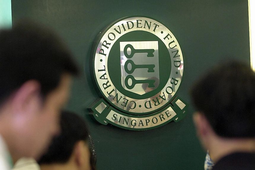 File photo showing people at a Central Provident Fund building in Singapore.