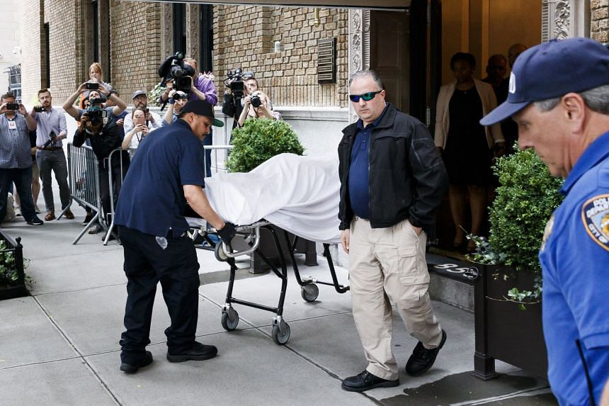 Members of New York's Chief Medical Examiner office transporting the body of designer Kate Spade from her apartment building after she reportedly committed suicide in New York, on June 5, 2018.