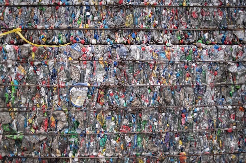 A block of compressed plastic bottles at a plastic waste centre on the outskirts of Beijing on May 16, 2018.