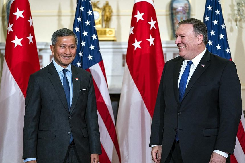 US Secretary of State Mike Pompeo (right) greeting Singapore's Foreign Minister Vivian Balakrishnan before the two held a working lunch at the Department of State in Washington, DC, on June 5, 2018.