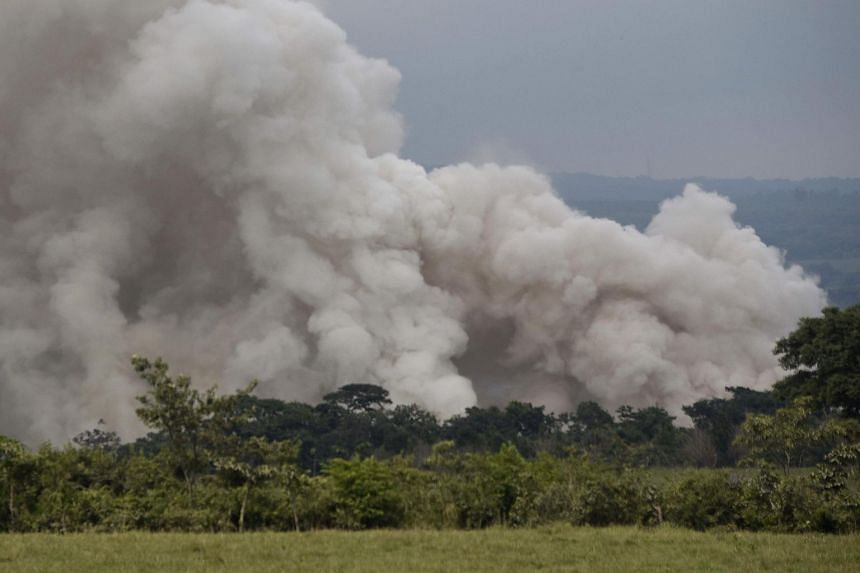 A smoke column billows from the lower part of the Fuego Volcano about 35km southwest of Guatemala City, on June 5, 2018.