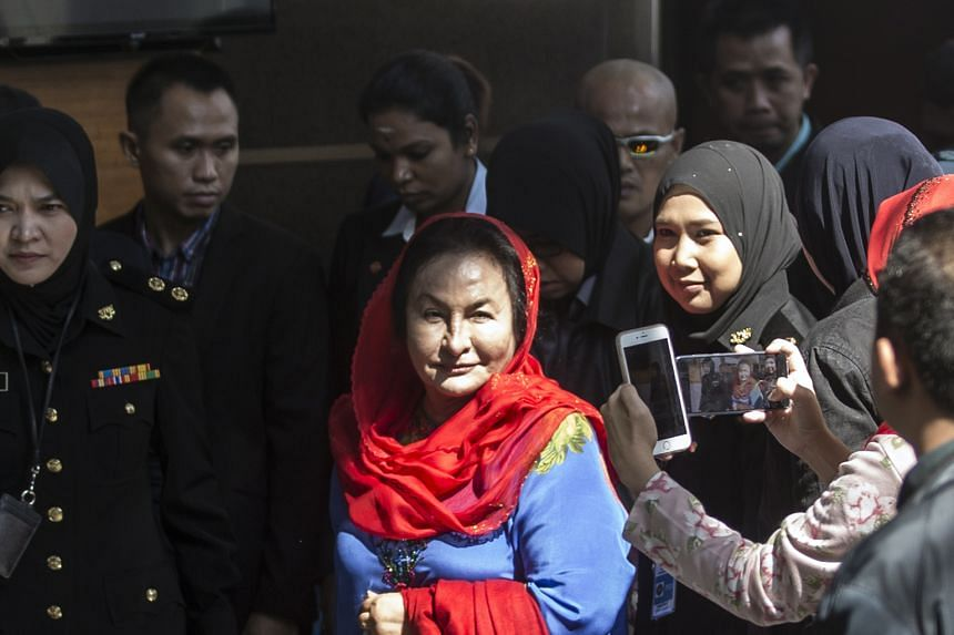 Datin Seri Rosmah Mansor being escorted by the authorities after she arrived at the Malaysian Anti-Corruption Commission in Putrajaya yesterday morning. She was questioned for five hours.