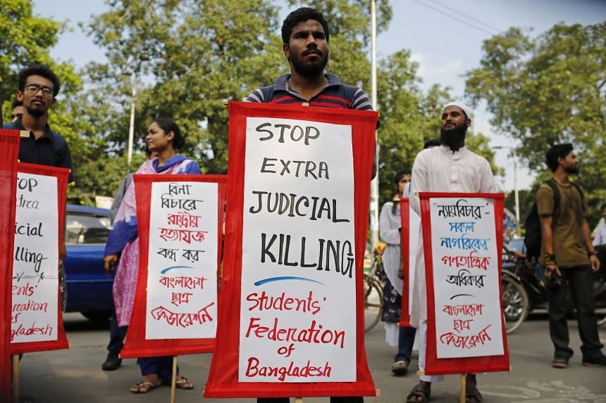 Students hold placards to protest against ongoing anti-drug measures in Dhaka, Bangladesh.