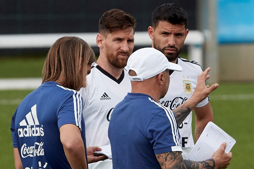 Argentina players Lionel Messi (centre) and Sergio Aguero attend a training session in Spain on June 6, 2018.