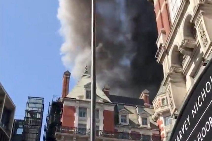 A blaze is seen at the Mandarin Oriental Hotel in Knightsbridge, London.