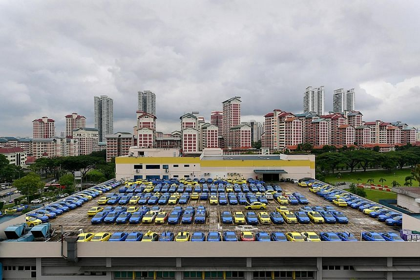 Comfort and CityCab vehicles parked at the CityCab Building in Sin Ming Avenue. Last month, ComfortDelGro called a tender for the supply of 500 more taxis - just a week after it announced that it had bought 200 new cabs, its first purchase in 18 mont