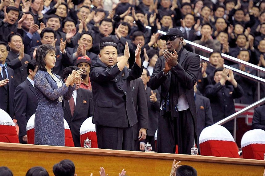 North Korean leader Kim Jong Un and his wife Ri Sol Ju with former NBA star Dennis Rodman at an exhibition basketball game in Pyongyang in 2013.