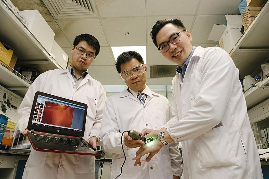 Members of the team involved in the nanoparticle technology research include (from left) research fellows Christian Wiraja and David Yeo (principal investigator) as well as Assistant Professor Xu Chenjie.