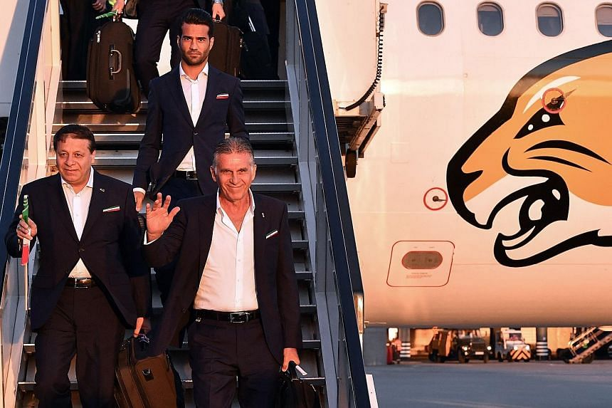 Iran's football coach Carlos Queiroz (right), officials and footballers arriving at Moscow's Vnukovo airport on Tuesday.