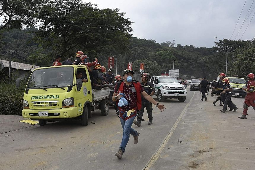 Volunteers and rescuers evacuating the disaster zone in the city of Escuintla, about 35 km south-west of Guatemala City, as the Fuego volcano's activity increased on Tuesday, halting rescue operations.