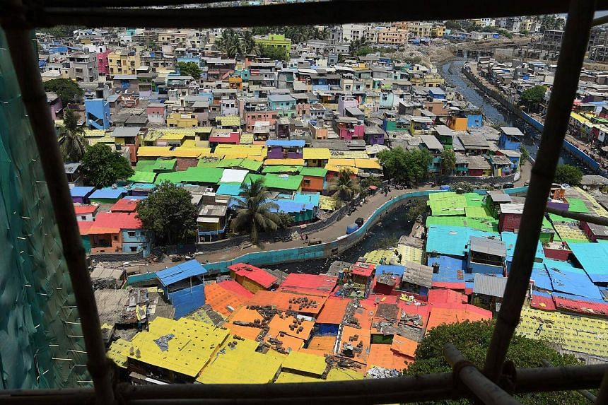 An aerial photo taken on June 2, 2018, shows a view of houses painted in bright colours at a fishing area in Mumbai, India.