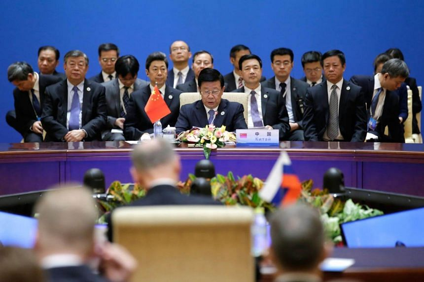 China's Minister of Public Security Zhao Kezhi (centre) speaking at a plenary meeting of the Shanghai Cooperation Organisation security secretary summit in Beijing, on May 22, 2018.