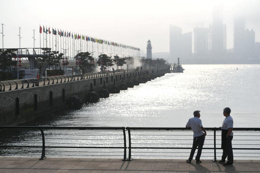 Men are seen outside the venue for the upcoming Shanghai Cooperation Organisation summit in Qingdao, Shandong province, China, on June 5, 2018.