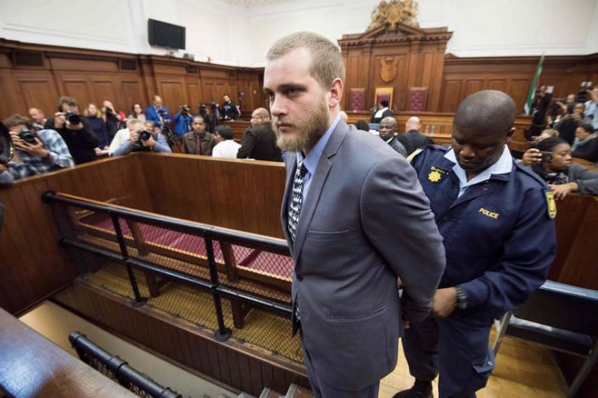 Henri van Breda is handcuffed and led out of the Western Cape High Court after being sentenced, in Cape Town, on June 7, 2018.