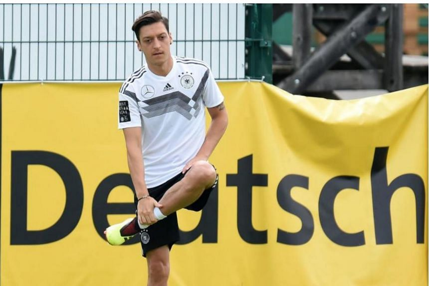 Mesut Ozil stretching during a training session with the German national football team in Eppan, northern Italy, on June 7, 2018.