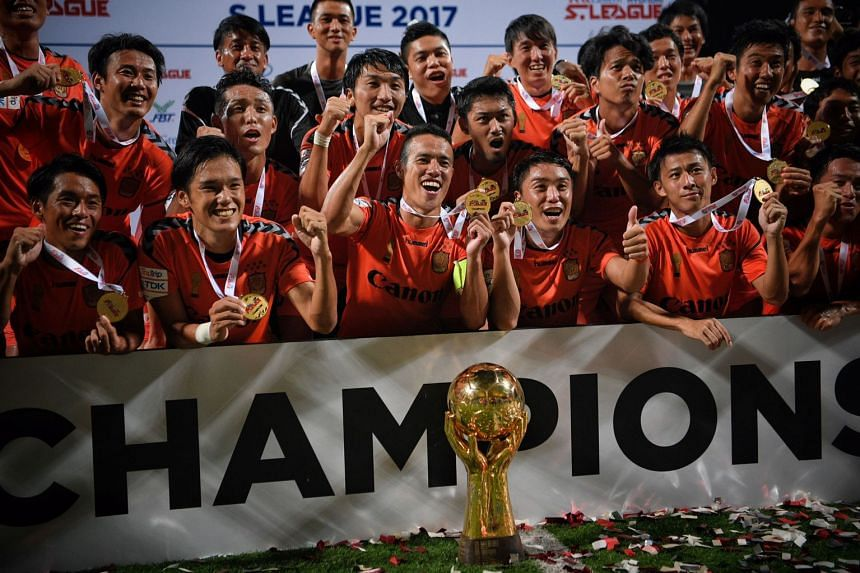 Albirex Niigata celebrate after being presented with the S-League winner's trophy in 2017.