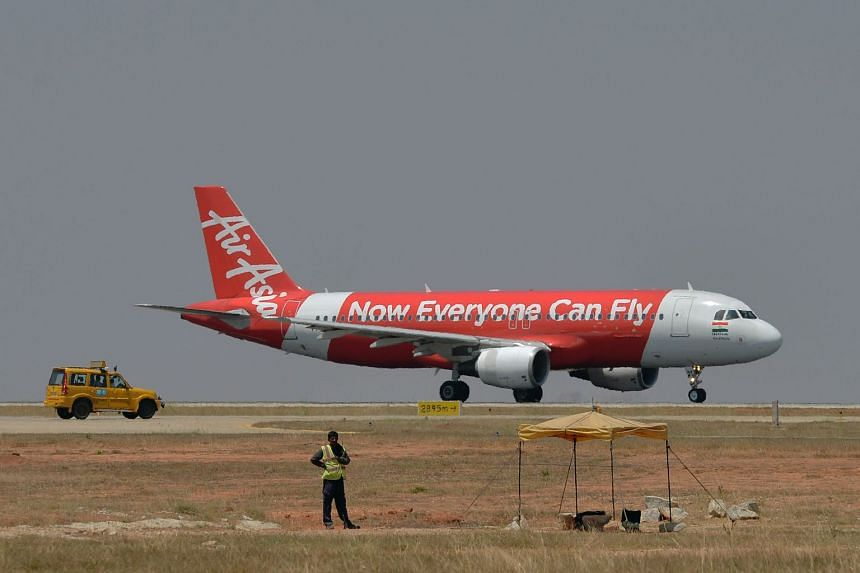 An AirAsia jet preparing to take off at the Kempe Gowda International Airport in Bangalore, India.