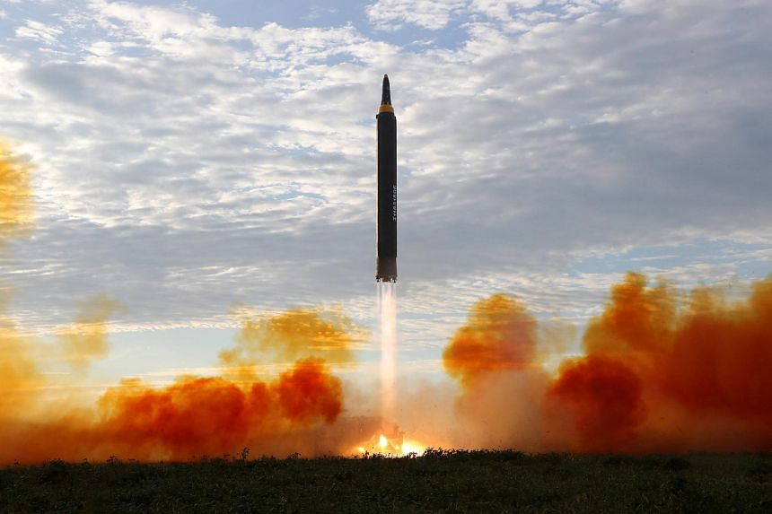 File photo showing the launch of a Hwasong-12 missile in North Korea on Sept 16, 2017.