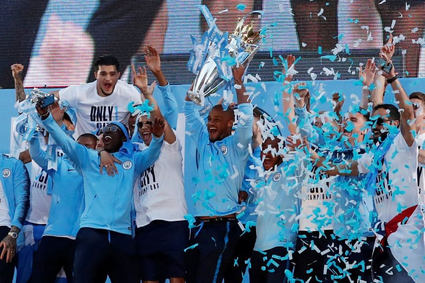 EPL Champions Manchester City lifting the trophy after winning the league, on May 14, 2018.