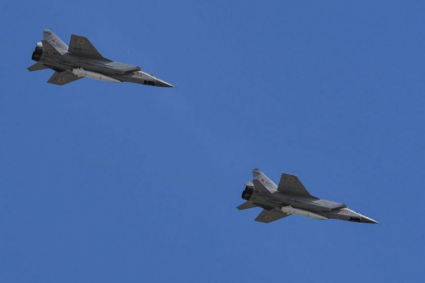 Russian MiG-31 supersonic interceptor jets carrying hypersonic Kinzhal (Dagger) missiles fly over Moscow.