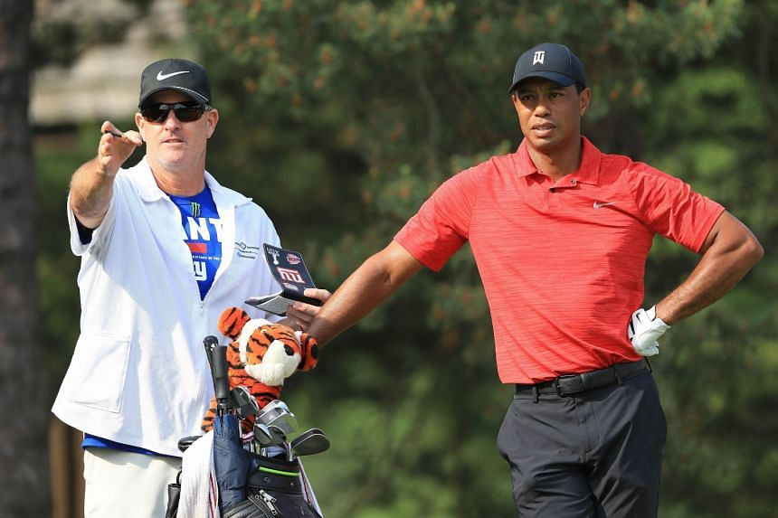 Tiger Woods talks with his caddie, Joe LaCava, on the second hole during the final round of The Memorial Tournament.