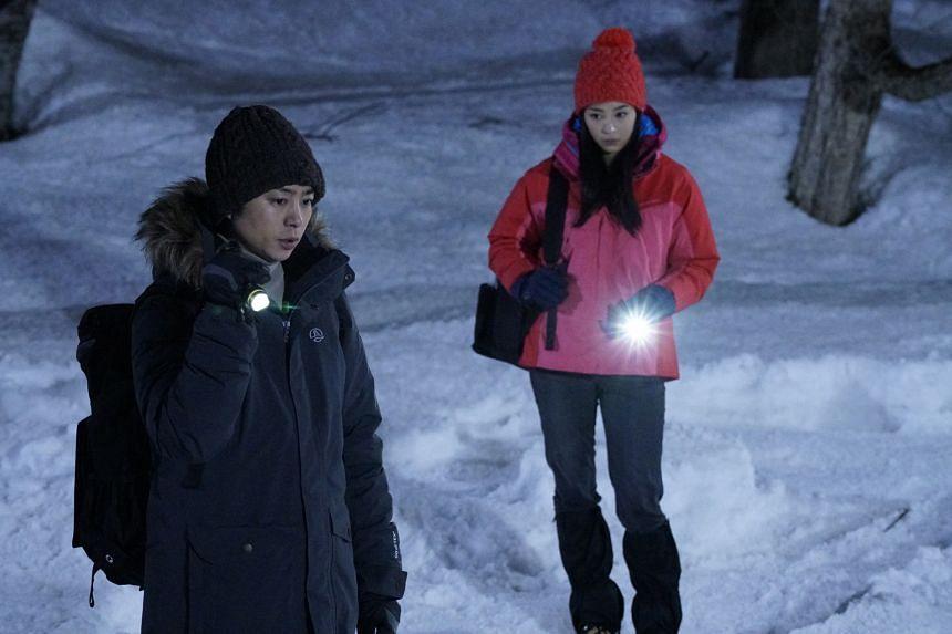 Sho Sakurai (left) and Suzu Hirose star in Laplace's Witch.
