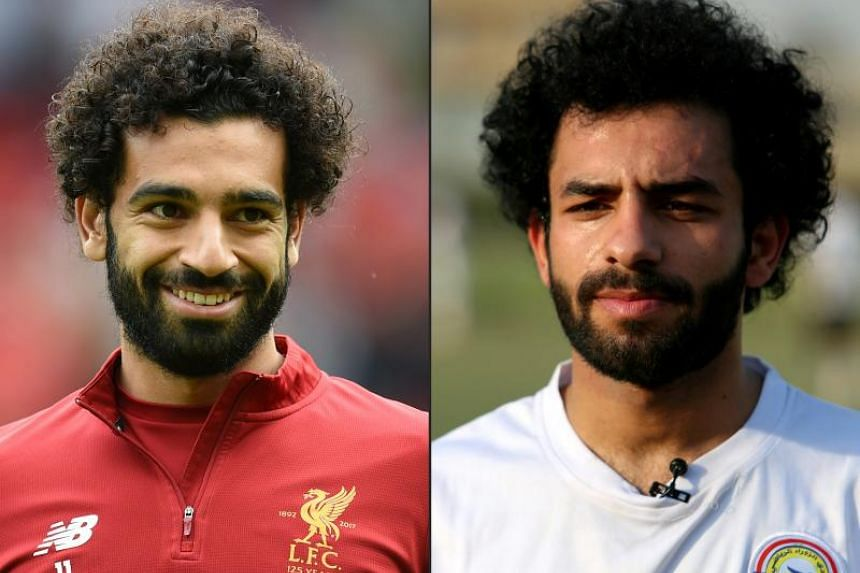 Iraqi footballer Hussein Ali (right) is frequently stopped in his working-class Hurriya neighbourhood by people wanting a photograph with their idol, Liverpool's Egyptian midfielder Mohamed Salah.