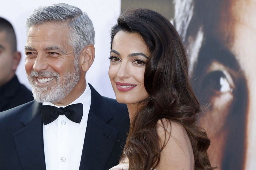 George and Amal Clooney arrive for the American Film Institute 46th Life Achievement Award Gala.