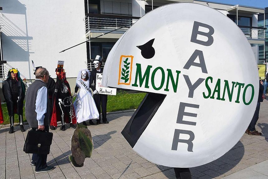 A protester in a pill-shaped costume during a rally last month against the merger of Bayer and Monsanto, in Bonn, Germany. Green groups are against the use of certain technologies to produce more food.