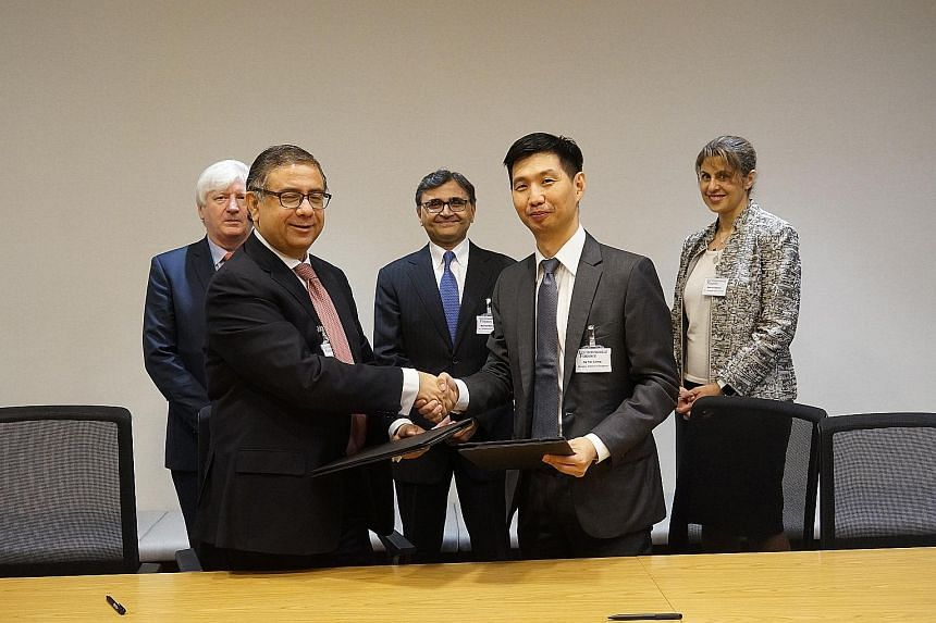 Mr Vivek Pathak, IFC's director for East Asia and the Pacific, and Mr Ng Yao Loong, MAS' assistant managing director, development and international group, at the signing of a memorandum of understanding, which will see both parties working together t