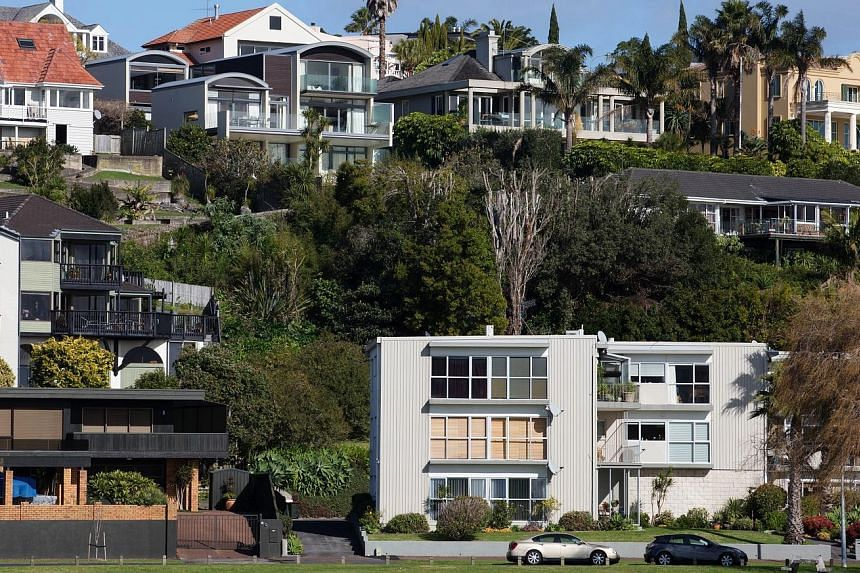 Houses in Saint Heliers in Auckland, New Zealand. The government has vowed to tackle a housing affordability crisis with a raft of measures, including a ban on foreign speculators buying residential property.