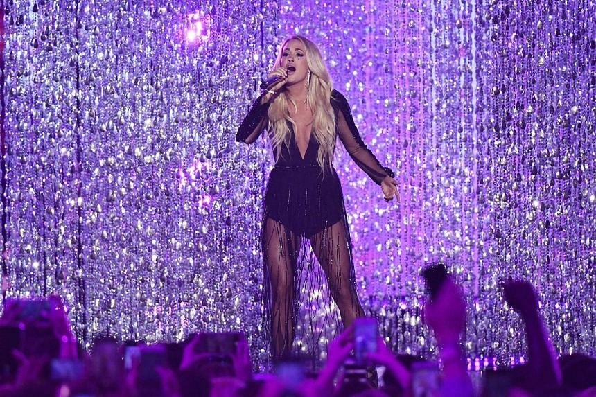 Backstreet Boys (above) and Carrie Underwood (left) performing at the CMT Awards on Wednesday in Nashville, where both bagged awards.