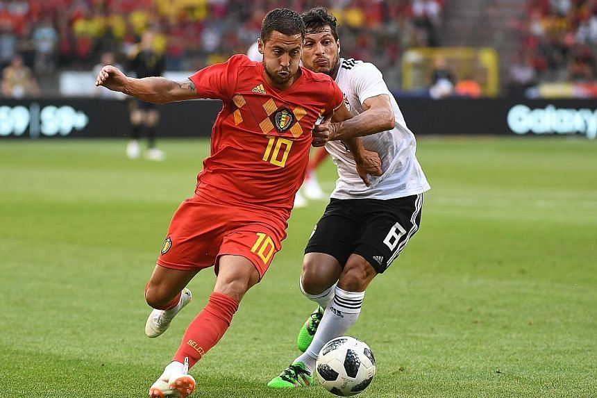 Eden Hazard (front) vying for the ball with Egypt midfielder Tarek Hamed during Belgium's 3-0 friendly win on Wednesday. Hazard said he will support Egypt at the World Cup because of his former Chelsea team-mate and friend Mohamed Salah, the African
