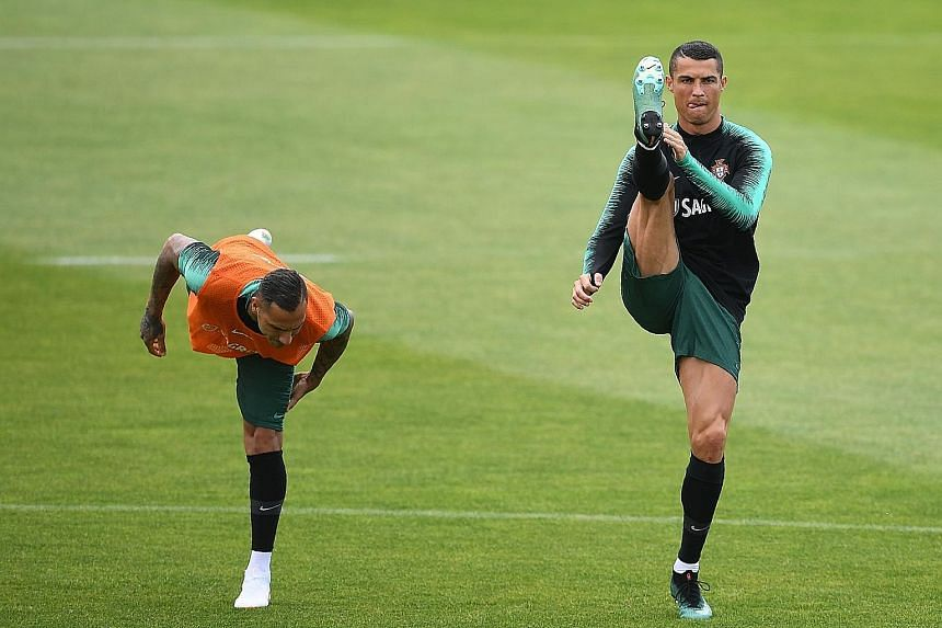 Portuguese forwards Cristiano Ronaldo (right) and Ricardo Quaresma during a training session in preparation for the World Cup Finals next week. Following their Euro 2016 win, Portugal will be hoping for success in Russia with their star player Ronald