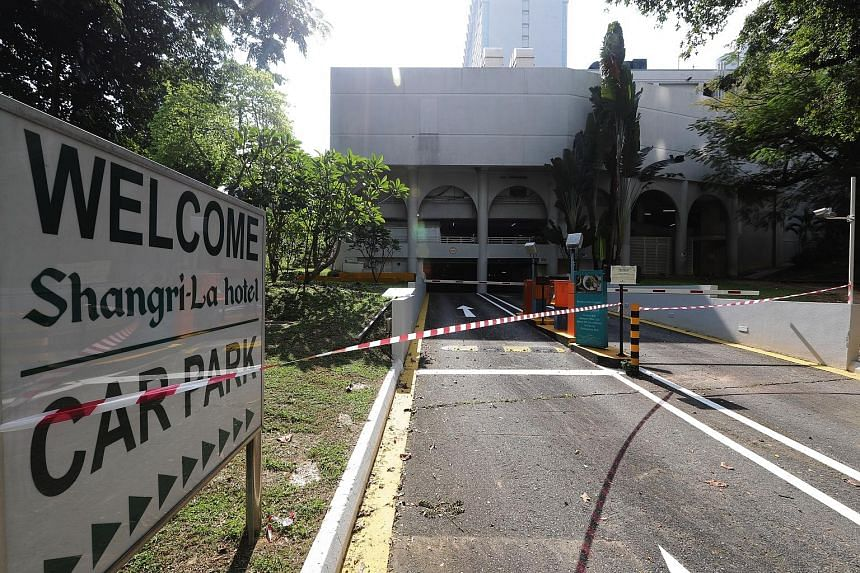 Security cameras have been set up at The St Regis hotel (above), while over at Shangri-La Hotel (below), the entrance to its carpark has been taped off, with a sign saying it would be closed until June 15.