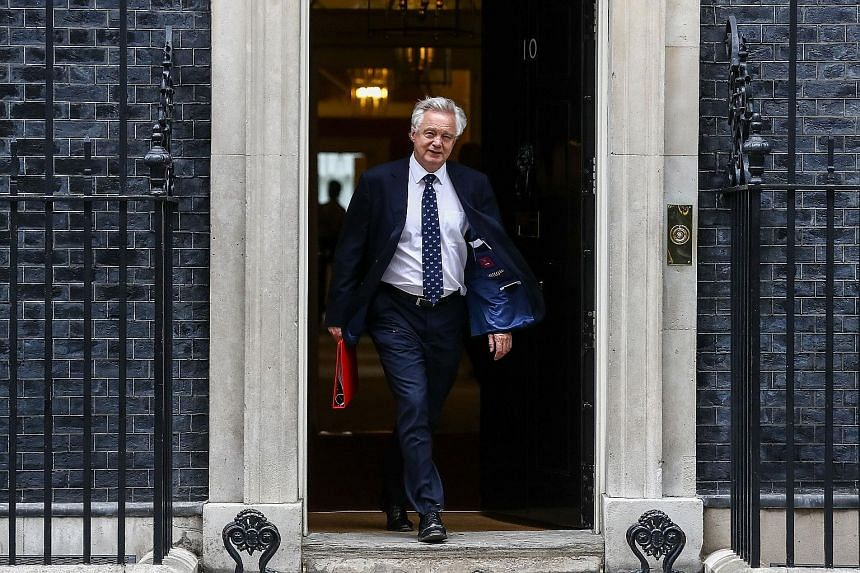"""Brexit Secretary David Davis leaving 10 Downing Street on Tuesday. There was speculation Mr Davis could quit over his disagreement with British PM Theresa May's """"backstop"""" proposal, and her latest decision was seen as a move to settle the row."""