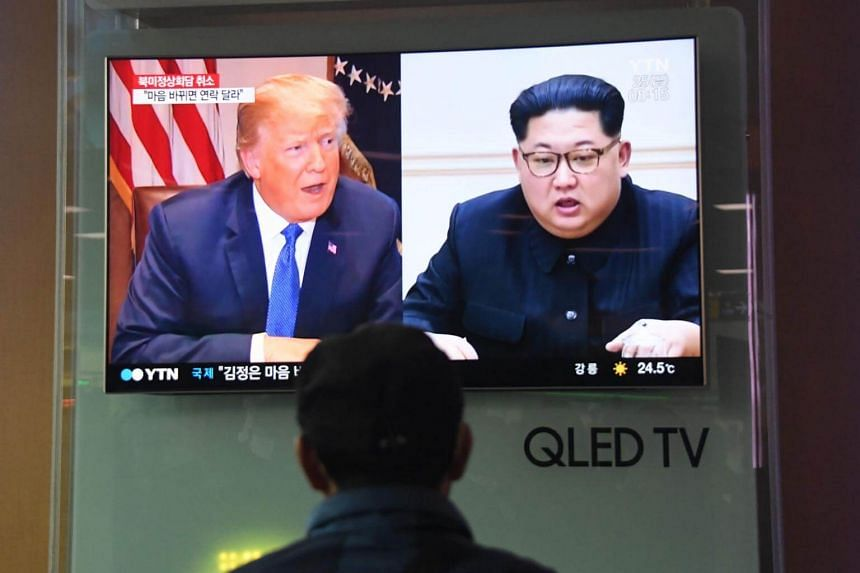 A TV news item showing North Korean leader Kim Jong Un and US President Donald Trump at a railway station in Seoul on May 25, 2018.