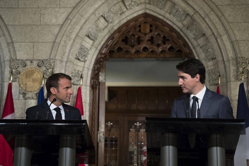 Canadian Prime Minister Justin Trudeau (right) and French President Emmanuel Macron hold a joint press conference at Parliament Hill in Ottawa, Canada, on June 7, 2018.