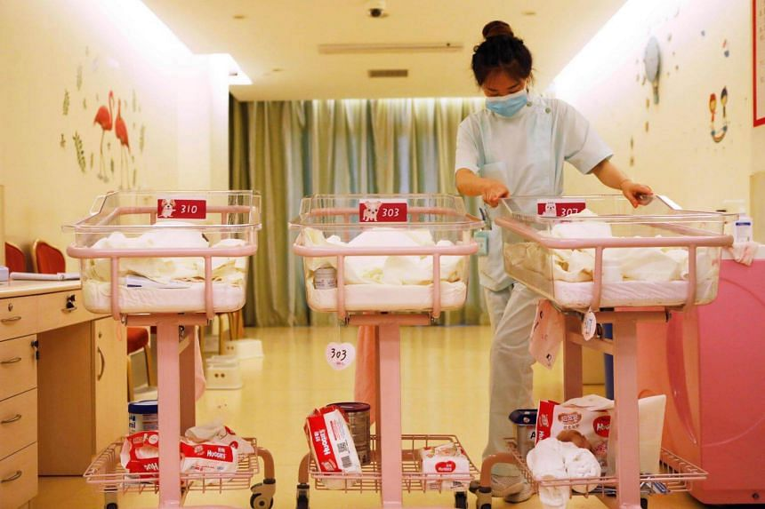 A Chinese staff member taking care of newborn babies at the Lake Malaren International Postpartum Care Centre in Shanghai on May 17, 2018.