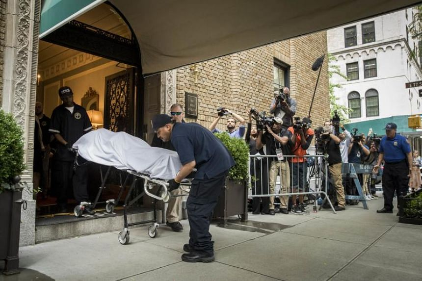 City workers carry the body of fashion designer Kate Spade out of her apartment building after she was found dead from suicide on June 5, 2018 in New York City.