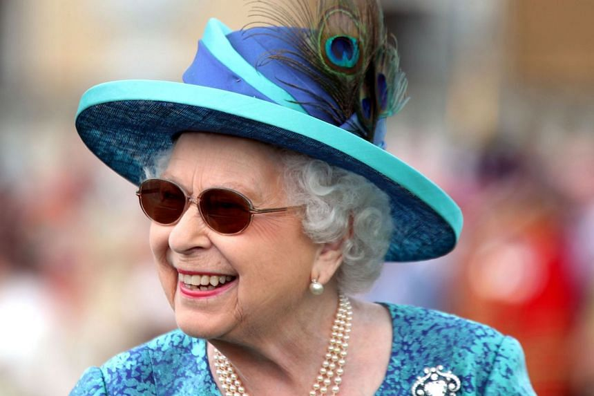 Britain's Queen Elizabeth II arrives for a garden party at Buckingham Palace in London in May 2018.