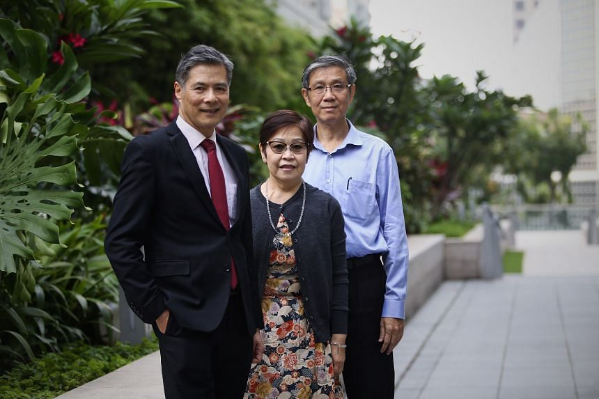 Professor Lim Seng Gee (at left) with Madam Ong Leng Mui, who has hepatitis C, and Mr Tan Koon How, a patient who has recovered from hepatitis B after participating in the clinical trial by NUH.