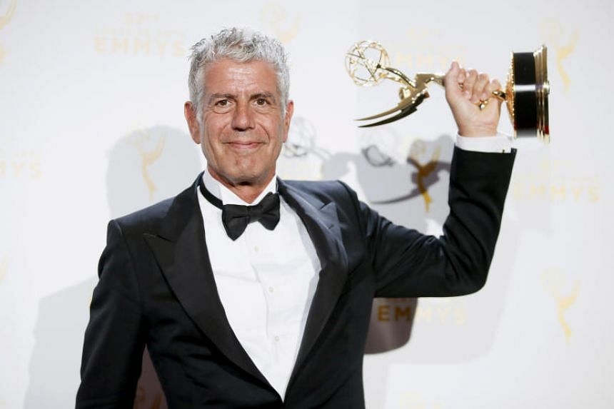 Anthony Bourdain poses with the outstanding informational series or special award for Anthony Bourdain Parts Unknown backstage at the 2015 Creative Arts Emmy Awards in Los Angeles, California, on Sept 12, 2015.