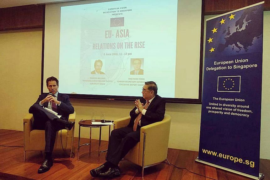 The European Union's Managing Director for Asia-Pacific Gunnar Wiegand (left) speaking an event at the Singapore Management University on June 8, 2018.